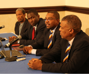 Dr. Douglas Slater of CARICOM, President of WIPA Wavell Hinds and Chief Executive of WICB Michael Muirhead listen to re-elected WICB President Dave Cameron (3rd from left) speak
