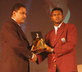Shivnarine Chanderpaul collects the Team of the Year on behalf of Guyana