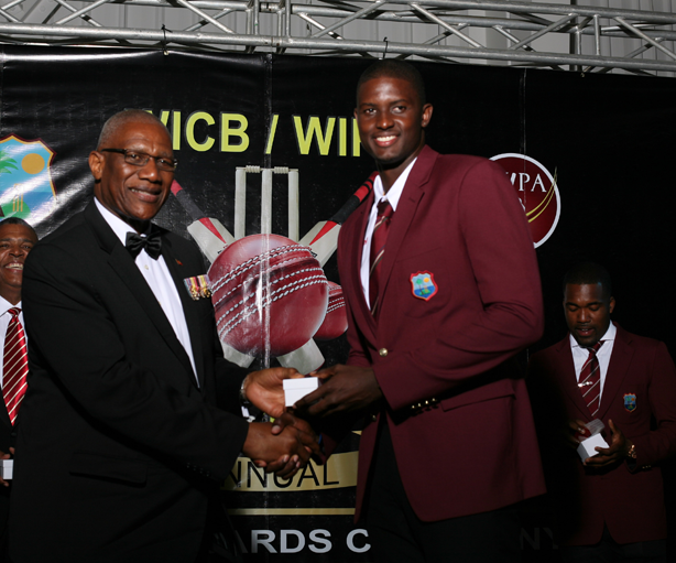 Jason Holder collecting his ring from the Governor General of Antigua