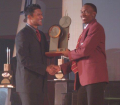 Dwayne Bravo collects Emerging Player of the Year on behalf of Denesh Ramdin