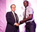 Rayvon Griffith accepts the First Class Team of the Year on behalf of Guyana