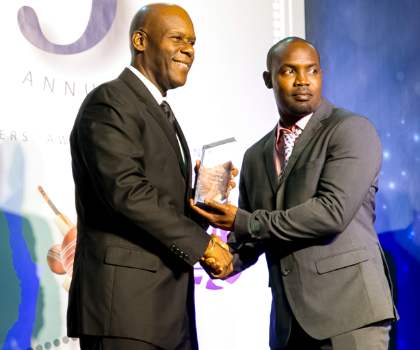 Travis Dowlin accepts the Under 19 Team of the Year Award on behalf of Guyana
